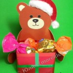 Новогодняя поделка «Медвежонок с подарком»