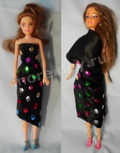 Игра с куклой Барби в модельера